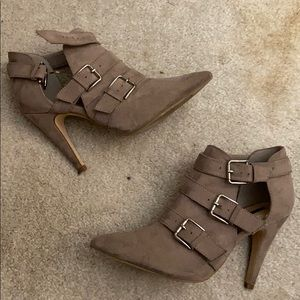 Pointy toed heels with buckles